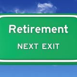 """Large green traffic sign that says """"Retirement Next Exit."""""""